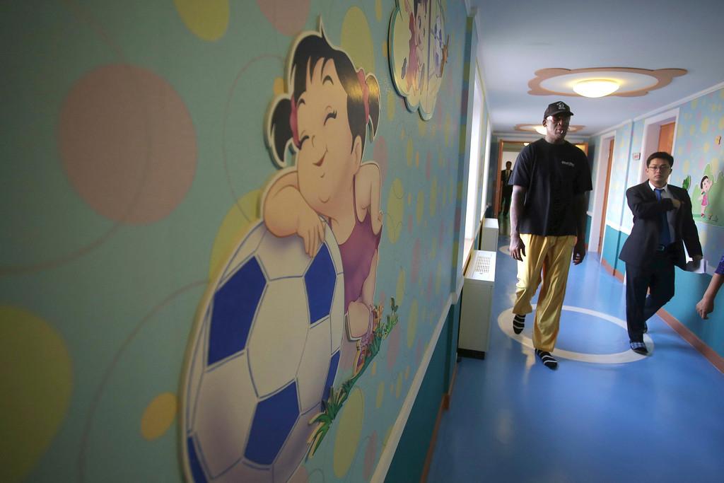 . Former NBA basketball star Dennis Rodman walks through the corridors of Pyongyang orphanage and nursery that he visited on Thursday, June 15, 2017, in Pyongyang, North Korea. (AP Photo/Kim Kwang Hyon)