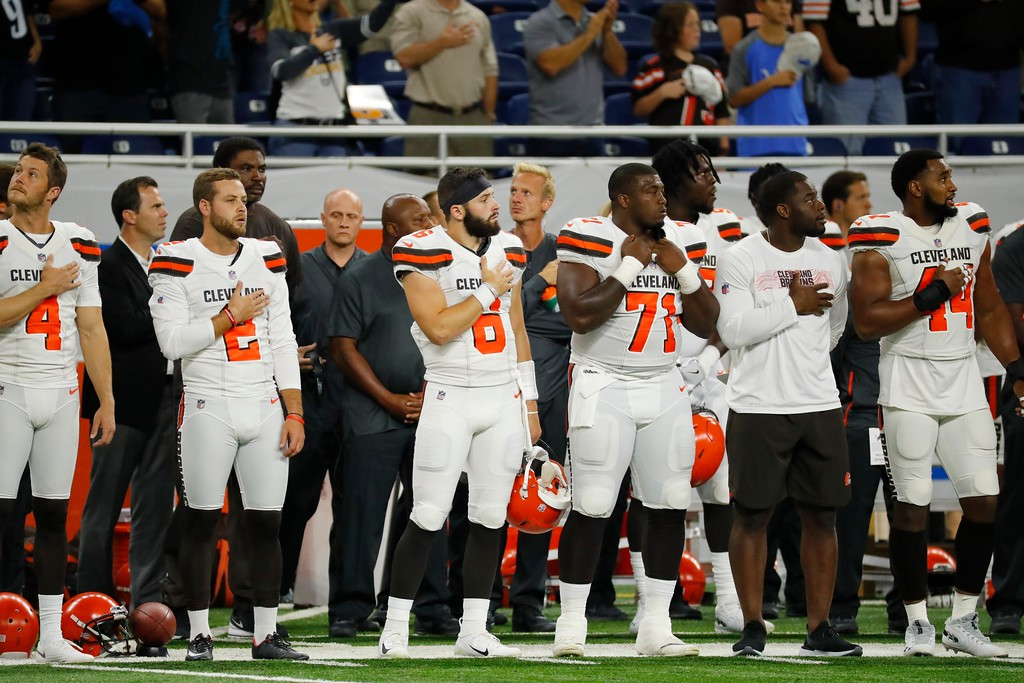 . Members of the Cleveland Browns stand during the anthem before the first half of an NFL football preseason game against the Detroit Lions, Thursday, Aug. 30, 2018, in Detroit. (AP Photo/Rick Osentoski)