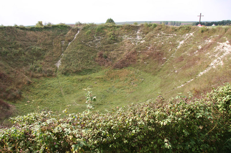 Le Grande Mine Crater at La Boiselle (just north of Albert) was created druing the opening stages of the Battle of the Somme (WWI) by tunnelling under the Germans and exploding a huge quantity of explosives.  It's huge!