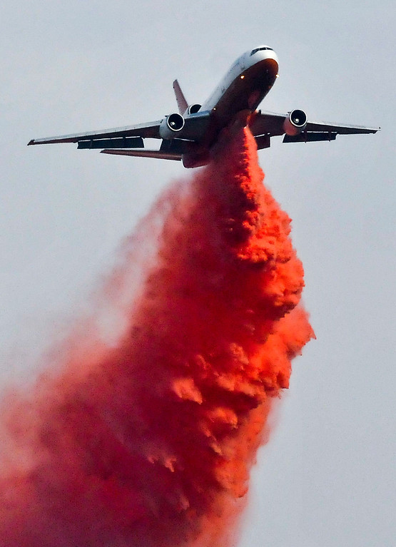 . A DC-10 makes a fire retardant drop on a brush fire in the canyons along Highway 243 south of Banning on Saturday, May 4, 2013. More than 400 firefighters battled the 650-acre fire on Saturday. (Rachel Luna / Staff Photographer)