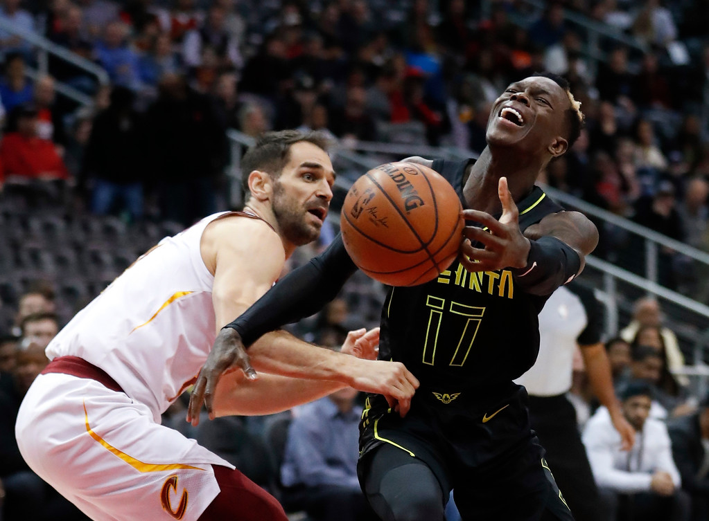 . Atlanta Hawks guard Dennis Schroeder (17) is fouled by Cleveland Cavaliers guard Jose Calderon (81) as he drives in the first half of an NBA basketball game Friday, Feb. 9, 2018, in Atlanta. (AP Photo/John Bazemore)