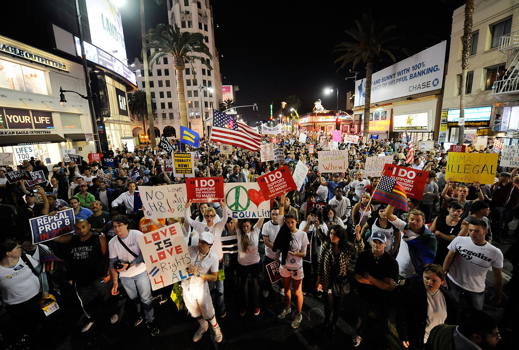 . LOS ANGELES, CA - MAY 26: Supporters of same-sex marriage carry signs during a rally in at Hollywood and Highland following the California Supreme Court\'s ruling to uphold Proposition 8 on May 26, 2009 in Los Angeles, California. The California State Supreme Court voted 6-1 to uphold proposition 8 which makes it illegal for same-sex couples to marry in the state of California. More than 18,000 same-sex couples that wed before prop 8 was voted in will still be legally married.  (Photo by Kevork Djansezian/Getty Images)