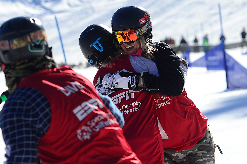 . ASPEN, CO - JANUARY 28: Daina Shilts hugs Hannah Teter after her run during the finals of the Special Olympics Unified Snowboarding at Winter X Games 2016 at Buttermilk Mountain on January 28, 2016 in Aspen, Colorado. (Photo by Brent Lewis/The Denver Post)