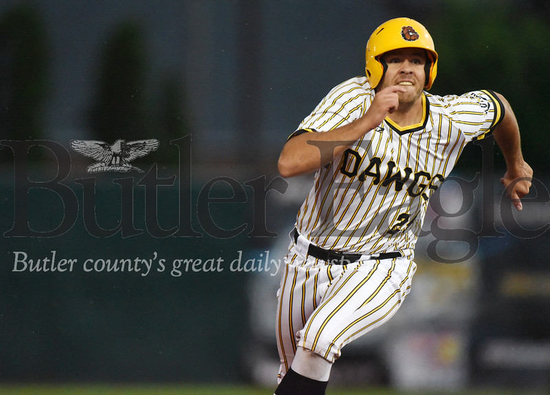 Harold Aughton/Butler Eagle: Diamond Dawgs #24 rounds second on his way to third base.