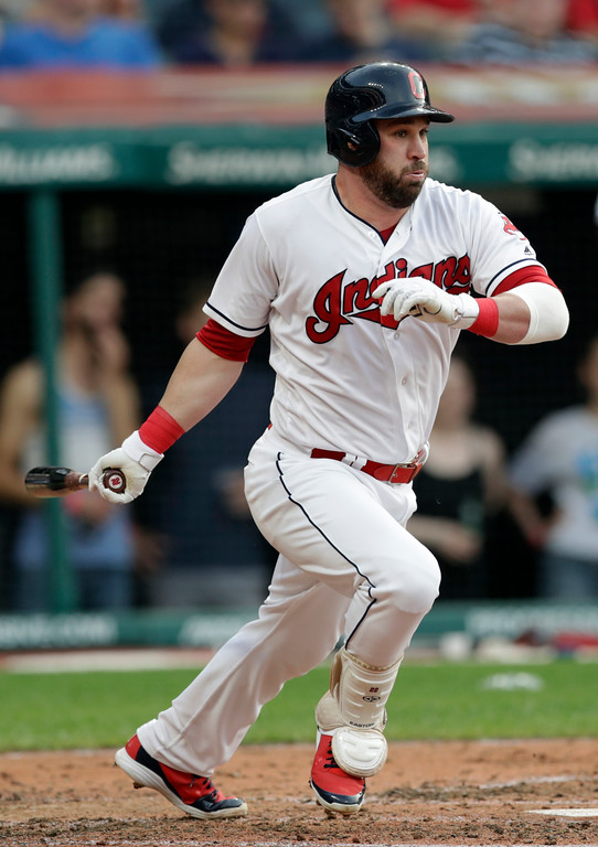 . Cleveland Indians\' Jason Kipnis hits an RBI-single off Chicago White Sox starting pitcher Dylan Covey in the third inning of a baseball game, Monday, June 18, 2018, in Cleveland. Rajai Davis scored on the play. (AP Photo/Tony Dejak)