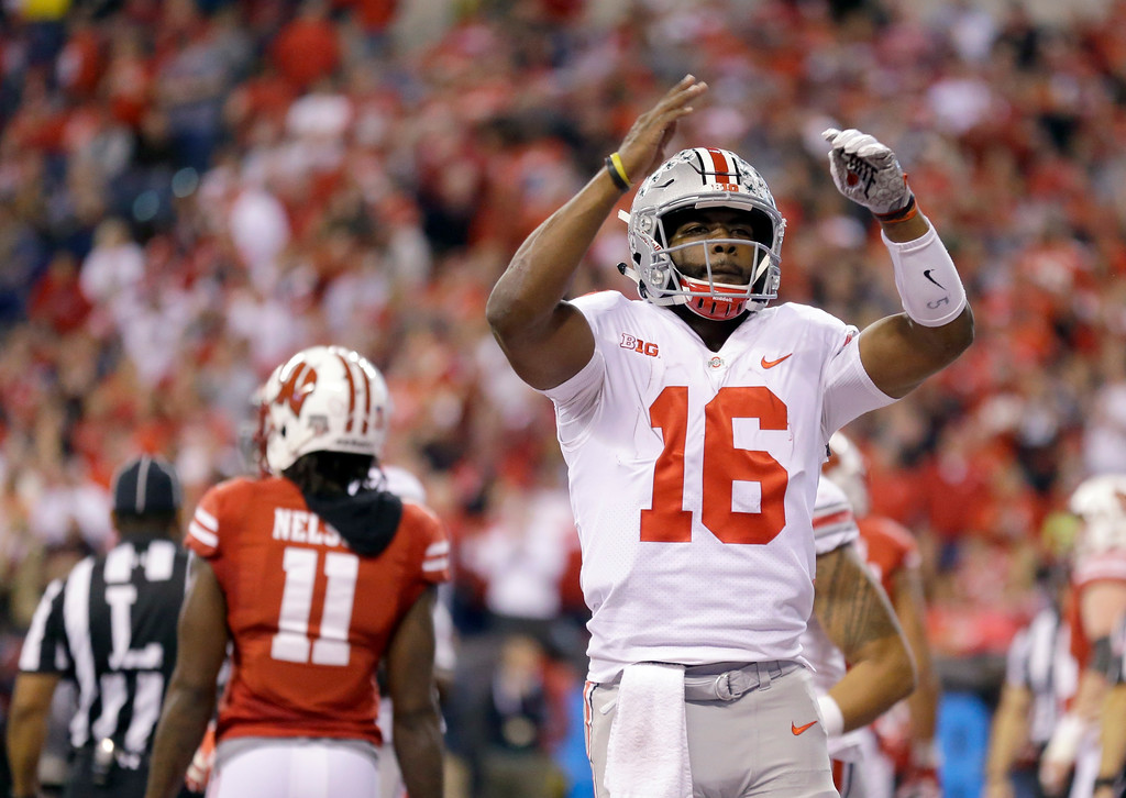 . Ohio State quarterback J.T. Barrett celebrates during the first half of the Big Ten championship NCAA college football game against Wisconsin, Saturday, Dec. 2, 2017, in Indianapolis. (AP Photo/Michael Conroy)