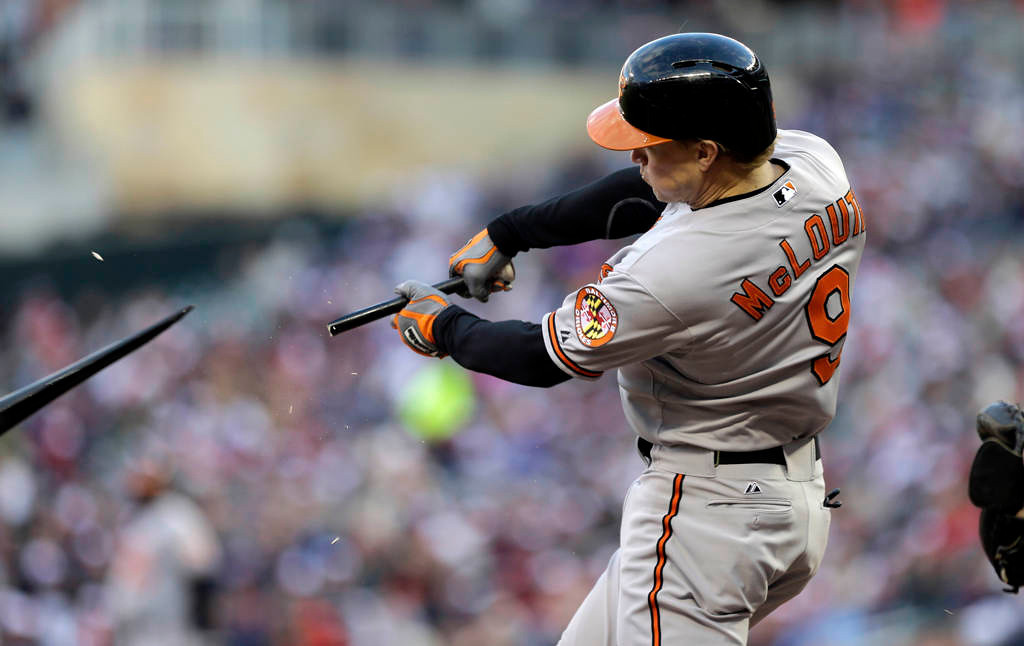 . Baltimore Orioles\' Nate McLouth\'s bat breaks as he flies out on a pitch from Minnesota Twins starting pitcher Vance Worley in the fourth inning.(AP Photo/Jim Mone)