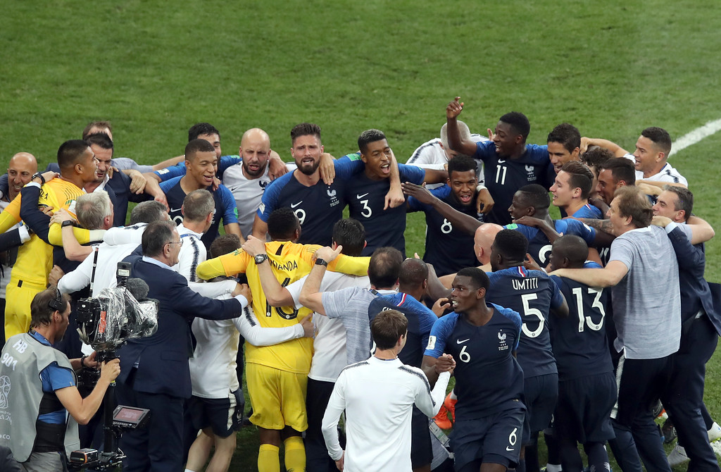 . French players celebrate at the end of the final match between France and Croatia at the 2018 soccer World Cup in the Luzhniki Stadium in Moscow, Russia, Sunday, July 15, 2018. (AP Photo/Thanassis Stavrakis)