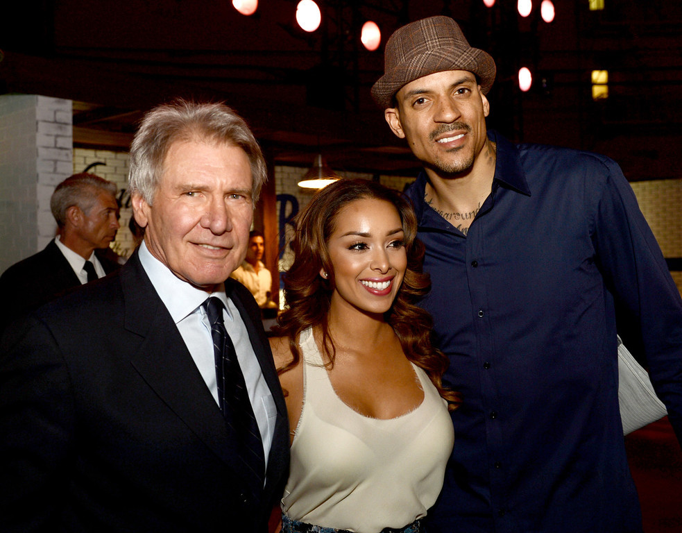 """. Actor Harrison Ford, Gloria Govan and L.A. Clippers basketball player Matt Barnes pose at the after party for the premiere of Warner Bros. Pictures\' and Legendary Pictures\' \""""42\"""" at the Chinese Theatre on April 9, 2013 in Los Angeles, California.  (Photo by Kevin Winter/Getty Images)"""