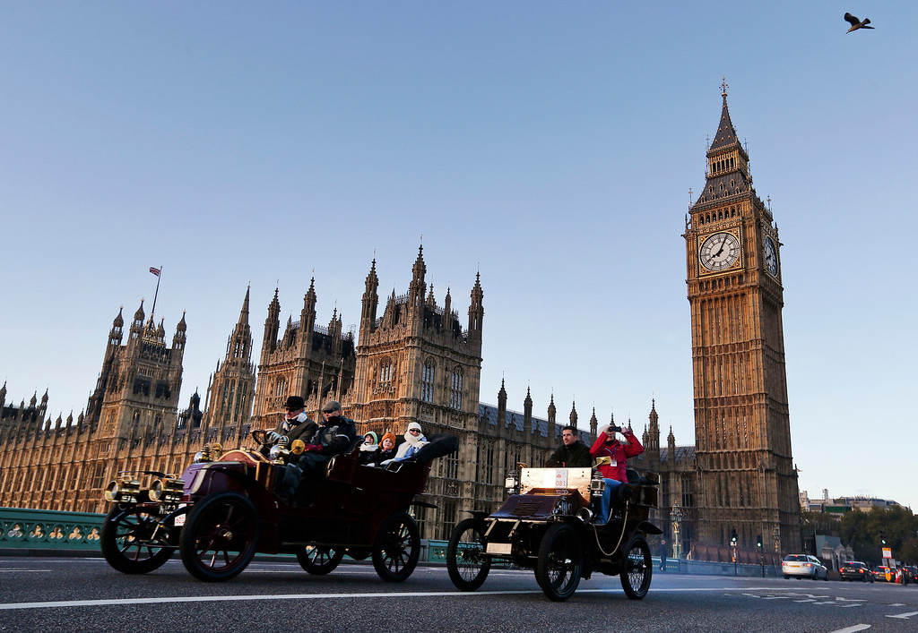 . Backdropped by the Houses of Parliament in central London,  participants drive their cars during the London to Brighton Veteran Car Run, Sunday, Nov. 3, 2013. Over 400 pre-1905 vehicles made their way on the historic 60-mile run from Hyde Park in London to coastal Brighton in southern England, in the world\'s longest running motoring celebration spanning 117 years. (AP Photo/Lefteris Pitarakis)