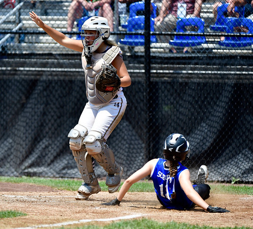 7/25/2019 Mike Orazzi | Staff Pennsylvania's Alizabeth Schuler (12) scores as Connecticut's Mya Dawid (14) waits for the ball during the Eastern Regional Softball Tournament at Breen Field in Bristol on Thursday.