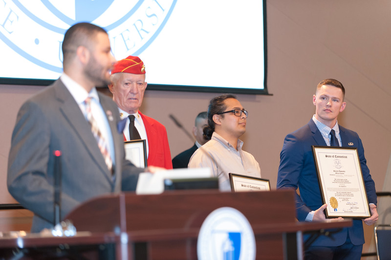 11/12/18  Wesley Bunnell | Staff  CCSU held a Veterans Day Observance on Monday afternoon in Alumni Hall which featured honoring three local veterans. Honoree Joshua Barnett, far R, looks on as New Britain Alderman Kristian Rosado reads a proclamation from the City of New Britain.