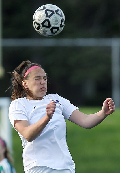 Zoe Gaffney, Birmingham Seaholm, goes up for a header during varsity soccer action against West Bloomfield at Seaholm High School Thursday, May 17, 2018. (For The Oakland Press / LARRY McKEE)