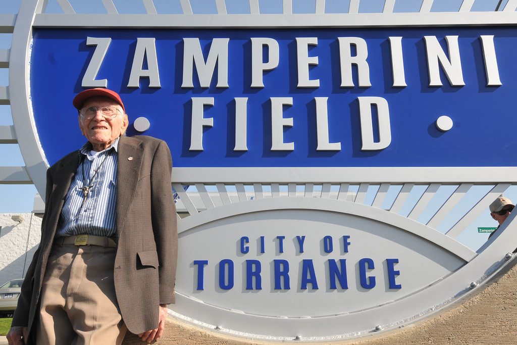 . Louis Zamperini was honored Tuesday with a new sign at the corner of Zamperini Way and Pacific Coast Highway; which leads to Zamperini Field airport. Zamperini was an Olympian and later a bombadier on a B-24 Liberator that was shot down over the Pacific. March 23, 2010. Photo by Steve McCrank