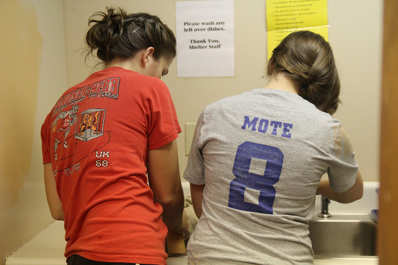 GWU's office of community engagement takes students to the men's homeless shelter of Shelby, NC to paint.
