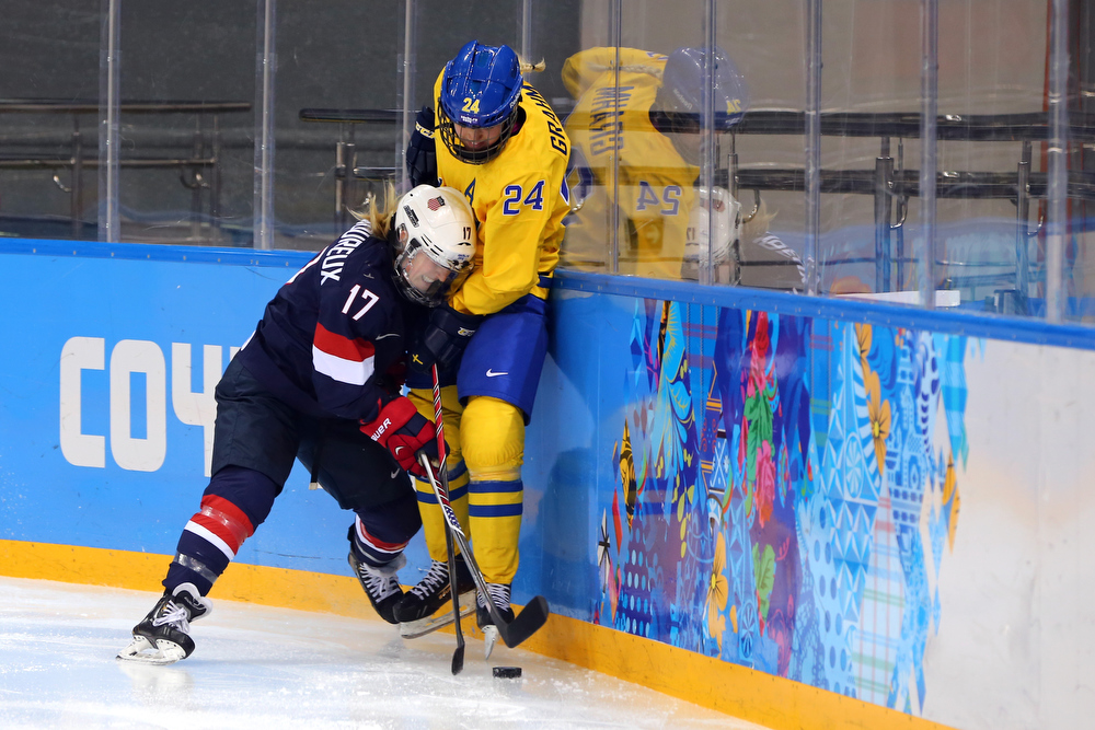 . SOCHI, RUSSIA - FEBRUARY 17: Jocelyne Lamoureux #17 of the United States collides with Erika Grahm #24 of Sweden in the third period during the Women\'s Ice Hockey Playoffs Semifinal game on day ten of the Sochi 2014 Winter Olympics at Shayba Arena on February 17, 2014 in Sochi, Russia.  (Photo by Martin Rose/Getty Images)