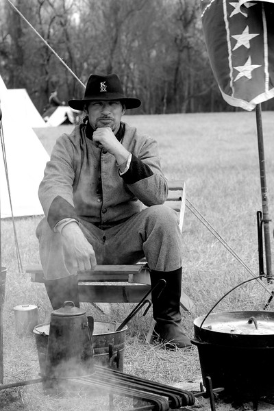 A gentleman with the 20th North Carolina Infantry, Company A catches my eye while relaxing in his camp. The Skirmish at Gamble's Hotel happened on March 5, 1885 when 500 federal soldiers, under the command of Reuben Williams of the 12th Indiana Infantry, marched into Florence to destroy the railroad depot but were met by Confederate soldiers backed up with 400 militia. The reenactment, held by the 23rd South Carolina Infantry, was held at the Rankin Plantation in Florence, South Carolina on Saturday, March 5, 2011. Photo Copyright 2011 Jason Barnette