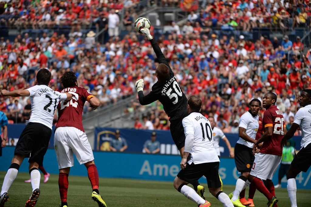 . Sam Johnstone of Manchester United (50) saves the goal from AS Roma during the 1st half of Guinness International Champions Cup 2014 at Sports Authority Field at Mile High,  Denver, Colorado, July 26, 2014. (Photo by Hyoung Chang/The Denver Post)
