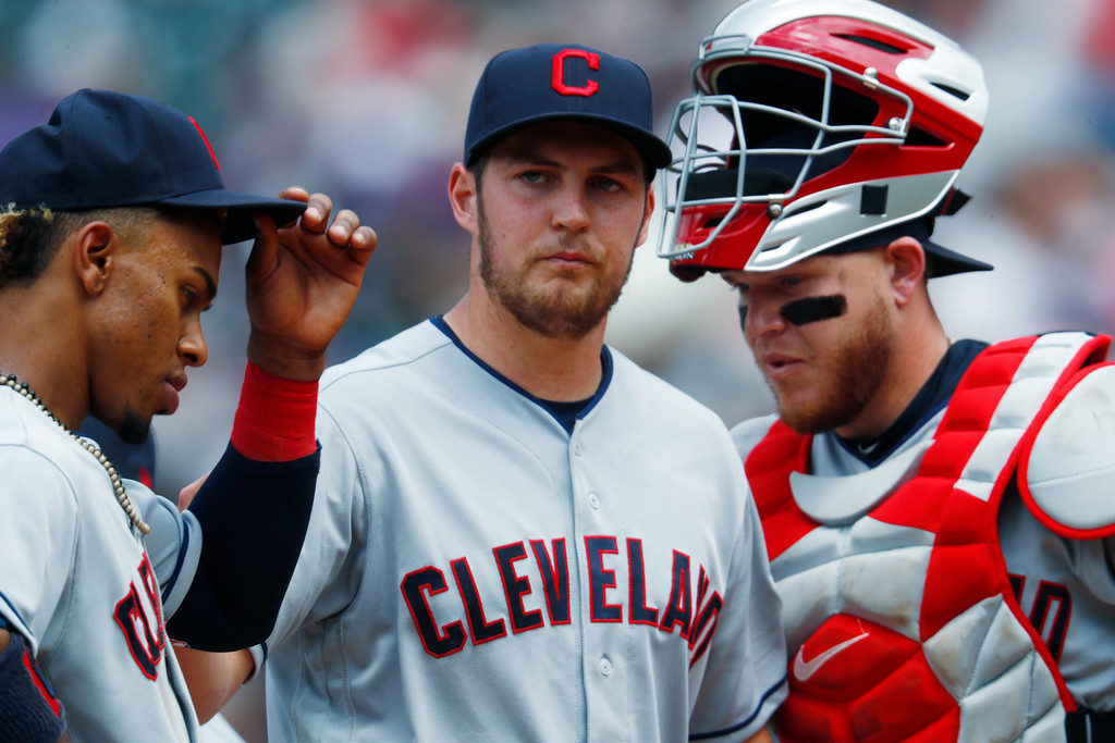 . Cleveland Indians starting pitcher Trevor Bauer, center, waits to be pulled from the mound with shortstop Francisco Lindor, left, and catcher Roberto Perez after Bauer gave up a two-run double to Colorado Rockies\' Charlie Blackmon during the fourth inning of a baseball game Wednesday, June 7, 2017, in Denver. Colorado won 8-1. (AP Photo/David Zalubowski)