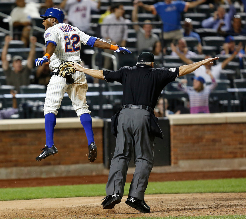 . New York Mets\'s Eric Young Jr. celebrates after scoring a run in the eighth inning of a baseball game against the Colorado Rockies at Citi Field, Tuesday, Aug. 6, 2013, in New York. (AP Photo/John Minchillo)