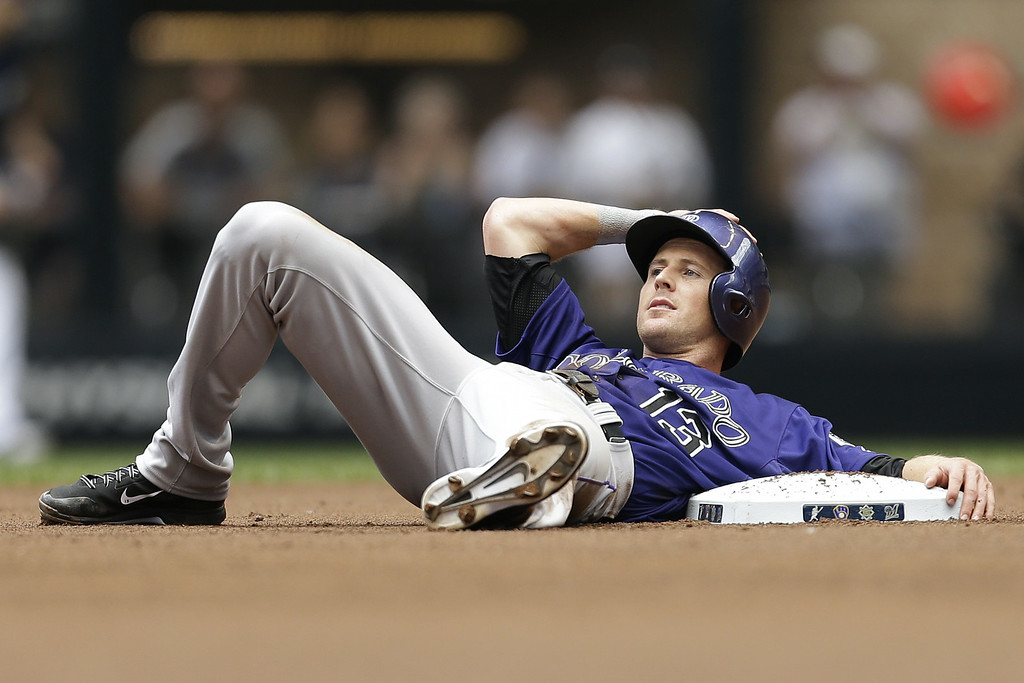 . MILWAUKEE, WI - JUNE 28: Drew Stubbs #13 of the Colorado Rockies lays at second base after getting tagged out in the top of the first inning against the Milwaukee Brewers at Miller Park on June 28, 2014 in Milwaukee, Wisconsin. (Photo by Mike McGinnis/Getty Images)