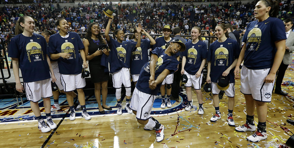 . The Connecticut team celebrate their win over Notre Dame 79-58 after the second half of the championship game in the Final Four of the NCAA women\'s college basketball tournament, Tuesday, April 8, 2014, in Nashville, Tenn. (AP Photo/Mark Humphrey)
