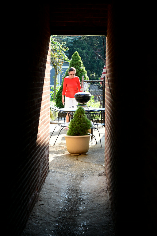 . PHOTO PETE BANNAN- Discover the secret garden of Terry Spadoni\'s  West Chester  row home.