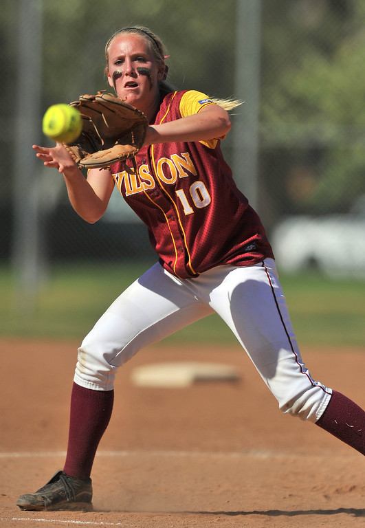 . LONG BEACH - 04/09/2013  (Photo: Scott Varley, Los Angeles Newspaper Group)  Lakewood vs Wilson girls softball at Joe Rodgers Field. Wilson pitcher Emilee Hoppe fields a ball hit right back to her before making the out at 1B.