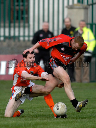Armaghs Andy Mallon is beaten to the Ball by Downs Benny Coulter. 07W13N260