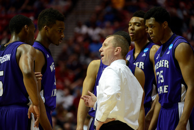 . Weber State Wildcats head coach Randy Rahe talks to his team during their game against the Arizona Wildcats in the second round of the 2014 NCAA Men\'s Basketball Tournament at Viejas Arena on March 21, 2014 in San Diego, California.  (Photo by Donald Miralle/Getty Images)