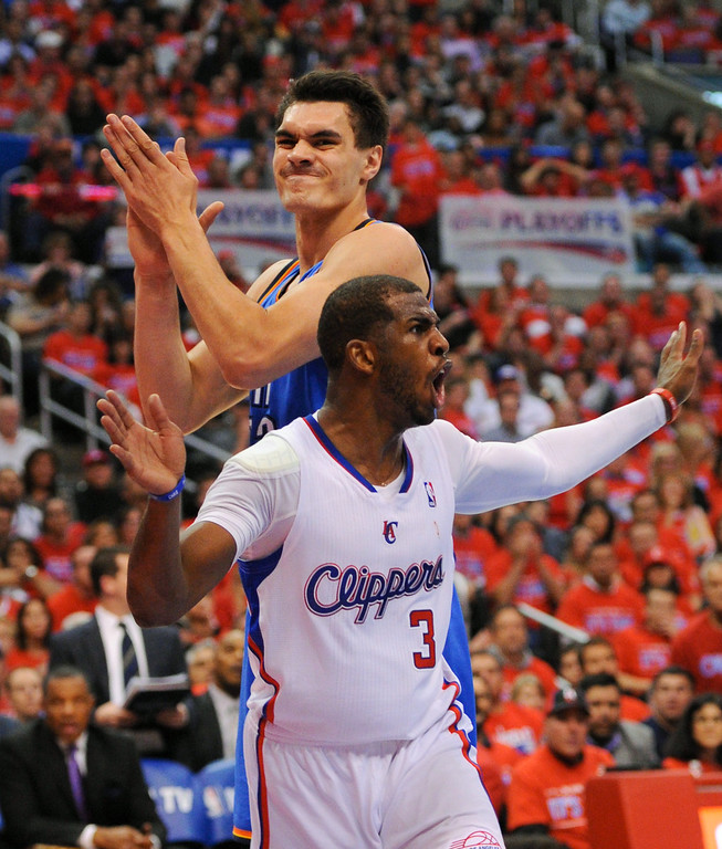 . Clippers\' Chris Paul and the Thunder\'s Steven Adams react differently on a loose ball that went out of bounds. The officials would overturn the call and award the ball to the Clippers. (Photo by Michael Owen Baker/Los Angeles Daily News)