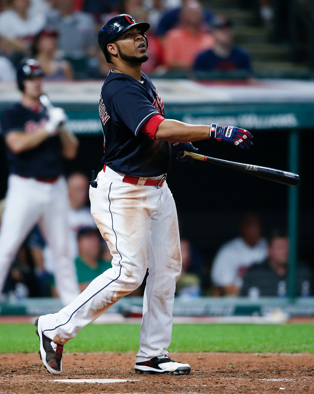 . Cleveland Indians\' Edwin Encarnacion hits a solo home run off Minnesota Twins relief pitcher Ryan Pressly during the seventh inning in a baseball game, Tuesday, Sept. 26, 2017, in Cleveland. (AP Photo/Ron Schwane)