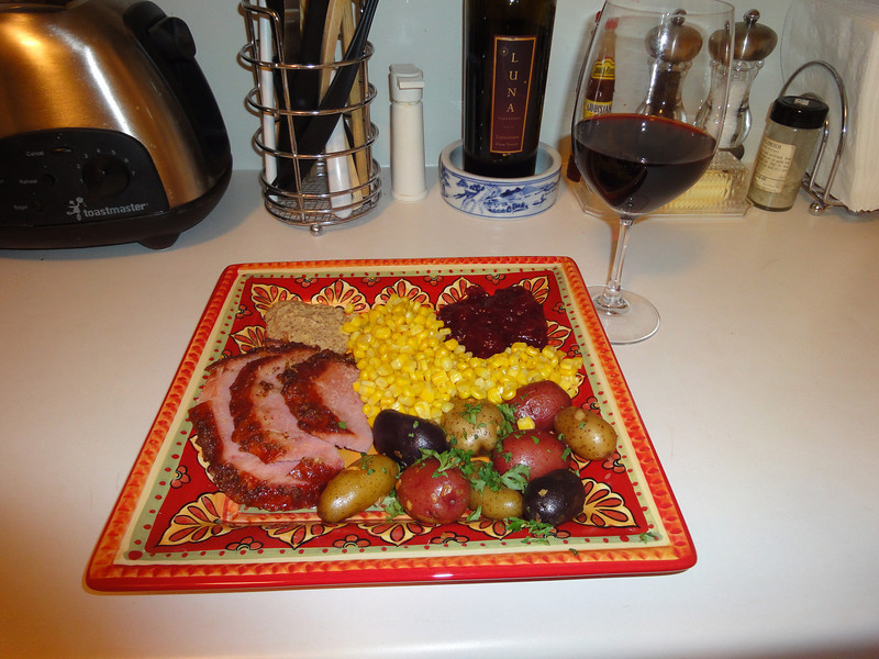 Christmas 2010 dinner. Baked ham w/brown sugar and mustard glaze, buttered parsley heirloom potatoes, sweet corn and cranberries.
