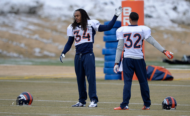 . Denver Broncos cornerback Marquice Cole (34) and Denver Broncos cornerback Tony Carter (32) stretch before practice January 15, 2014 at Dove Valley (Photo by John Leyba/The Denver Post)