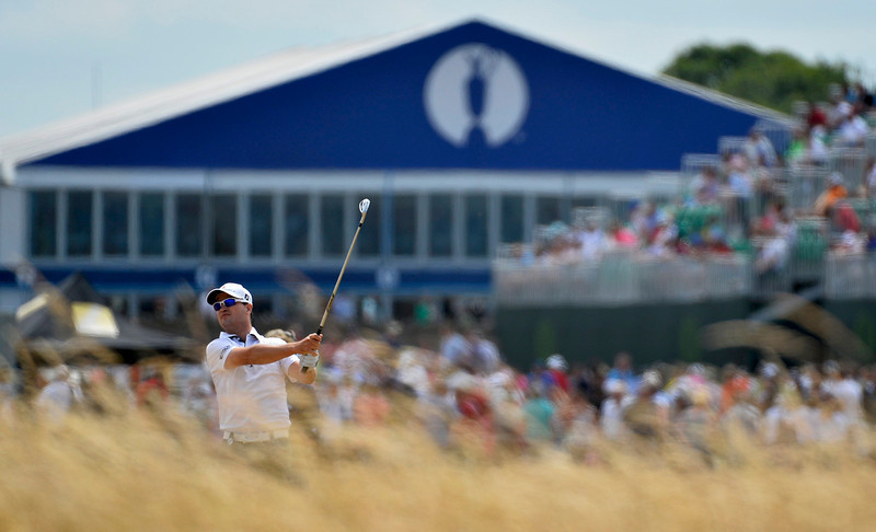 . Zach Johnson of the U.S. watches his second shot on the tenth hole during the first round of the British Open golf Championship at Muirfield in Scotland July 18, 2013.   REUTERS/Toby Melville