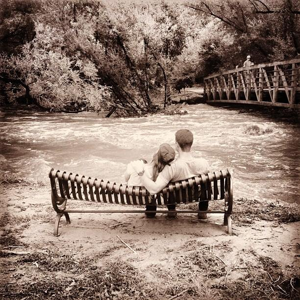 . After two long days of a flooded house and evacuating, these two take a break on the bench to watch the rush of Boulder Creek go by. Photo Bella Vitale