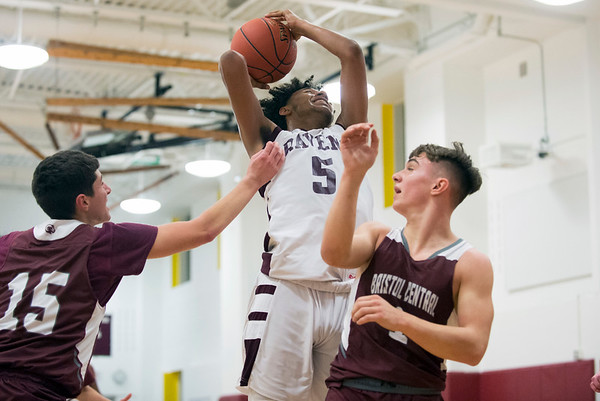 01/15/20 Wesley Bunnell | StaffrrInnovation boys basketball was defeated by Bristol Central at home Wednesday January 15, 2019. Innovation's LJ Hazelwood (5) with a shot guarded by Shane Ouellette (15) and