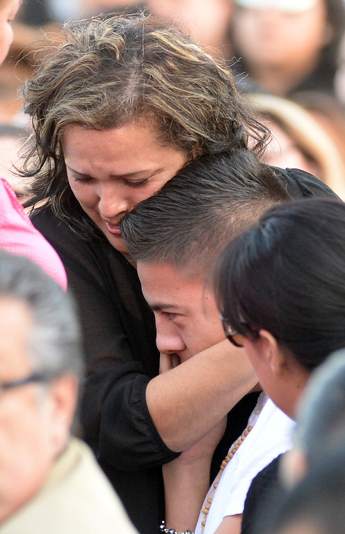 . Veronica Soriano, mother of Adrian Castro, 19,hugs one of the bus crash survivors before a memorial gathering for him at El Monte High School Monday evening April 14, 2014. Castro was one of nine students killed in the bus crash in Orland, Calif. (Staff Photo by Keith Durflinger/San Gabriel Valley Tribune)