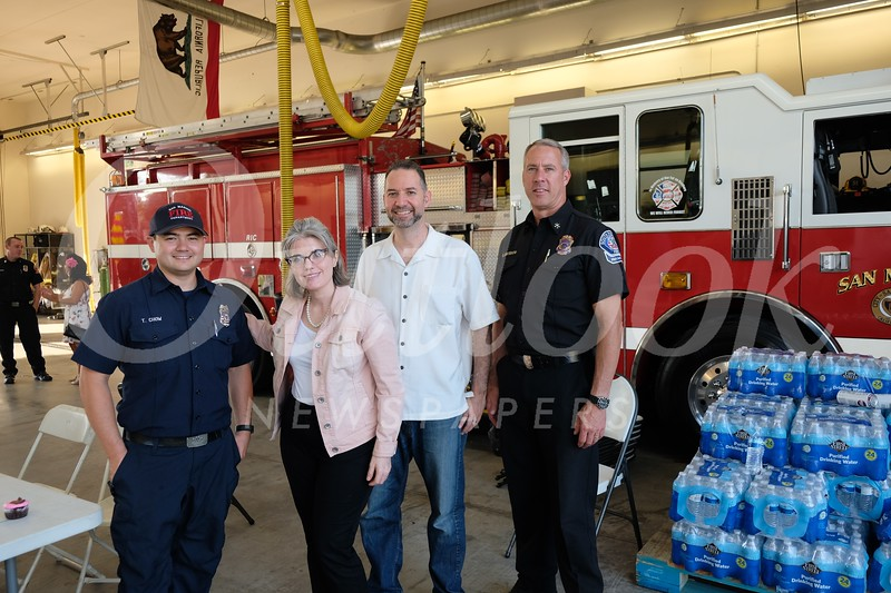 Tim Chow, Rebecca and James Donvito, and Division Chief Eric Zanteson.jpg