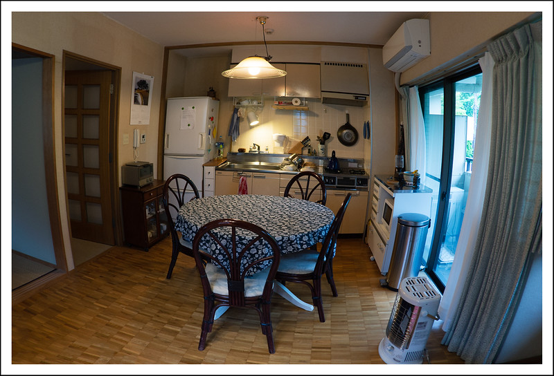 The kitchen - dining area taken with a fisheye lens.
