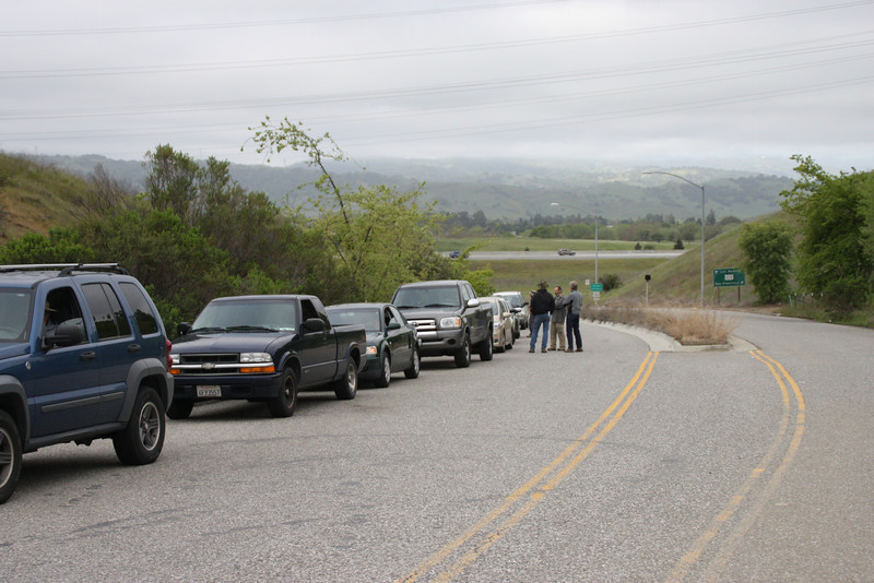 Hikers' cars waiting to get through the landfill gates. U.S. Route 101 is in the background in Coyote Valley, with the Santa Cruz mountains behind.