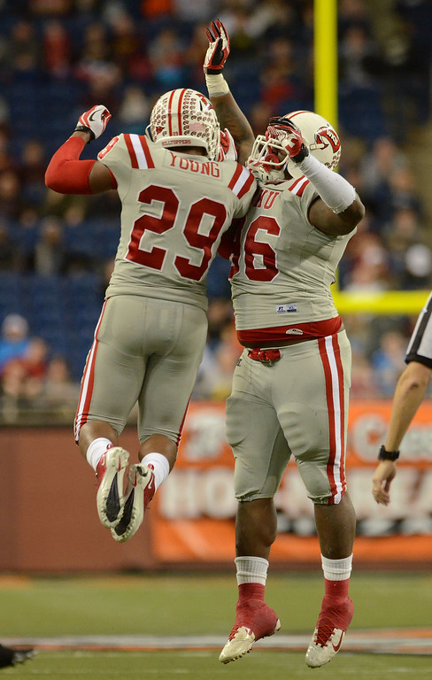 . DETROIT, MI - DECEMBER 26:  Kiante Young #29 and Rammell Lewis #96 of the Western Kentucky University Hilltoppers celebrate a play in the second quarter of the Little Caesars Pizza Bowl against the Central Michigan University Chippewas at Ford Field on December 26, 2012 in Detroit, Michigan.  (Photo by Mark A. Cunningham/Getty Images)