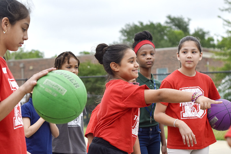Joselyn Arroyo, 10, picks a team member for a basketball game during Sports Day hosted by Robert E. Lee students at Douglas Elementary School in Tyler, Texas, on Friday, May 19, 2017. The event was organized in part by teacher Mrs. Jones and her son Royland Black as a way to motivate and reward students for their hard work at the end of the school year. (Chelsea Purgahn/Tyler Morning Telegraph)