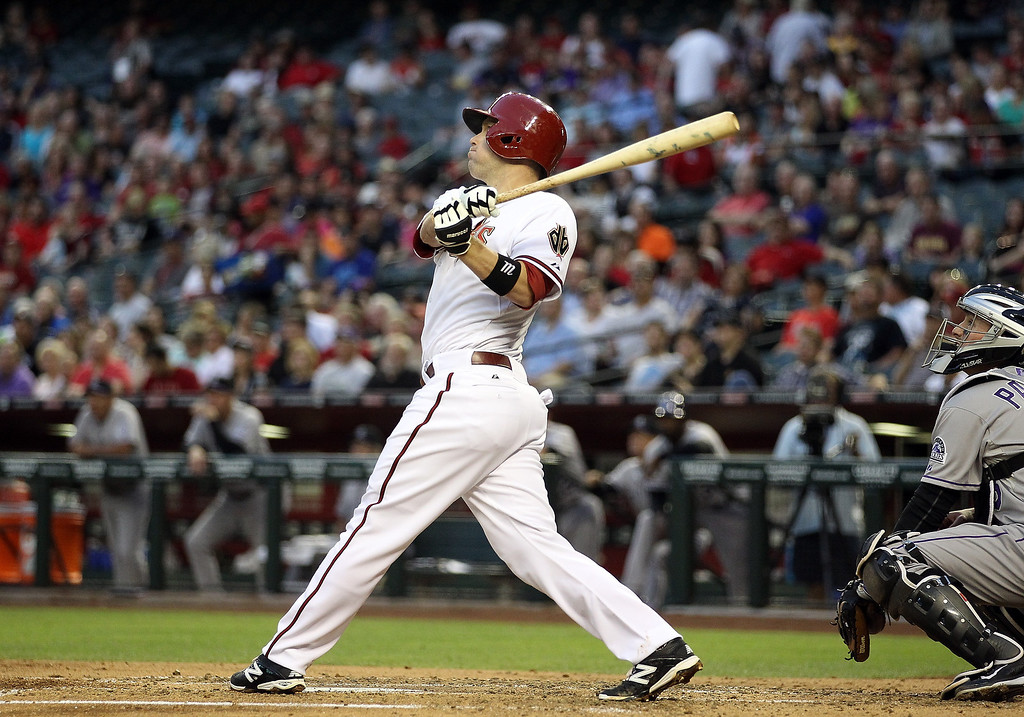 . Aaron Hill #2 of the Arizona Diamondbacks hits a sacrifice fly against the Colorado Rockies during the second inning of the MLB game at Chase Field on April 29, 2014 in Phoenix, Arizona.  (Photo by Christian Petersen/Getty Images)