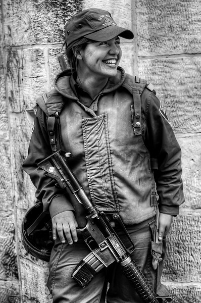 Mijal 18 is a serving member of the IDF. She is currently doing her military service in Jerusalem. Every day she descends the old city and patrols its streets keeping the peace between the different religious groups.  Jerusalem, Israel, 2012.