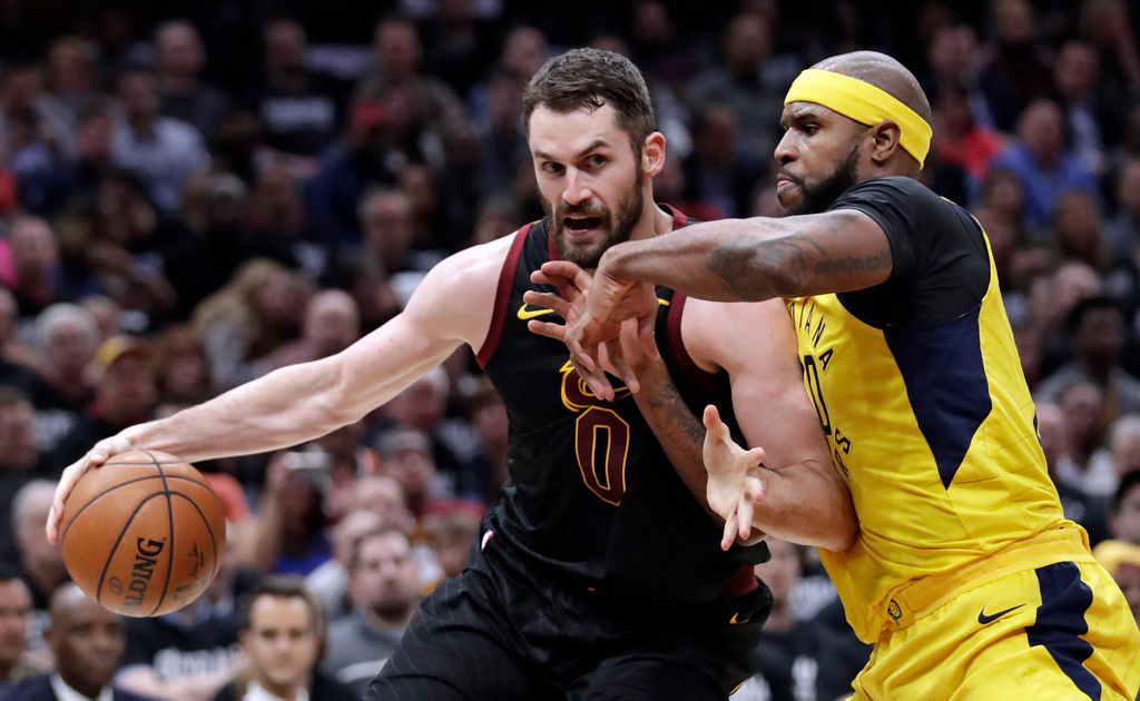 . Cleveland Cavaliers\' Kevin Love, left, drives against Indiana Pacers\' Trevor Booker during the first half of Game 2 of an NBA basketball first-round playoff series Wednesday, April 18, 2018, in Cleveland. (AP Photo/Tony Dejak)