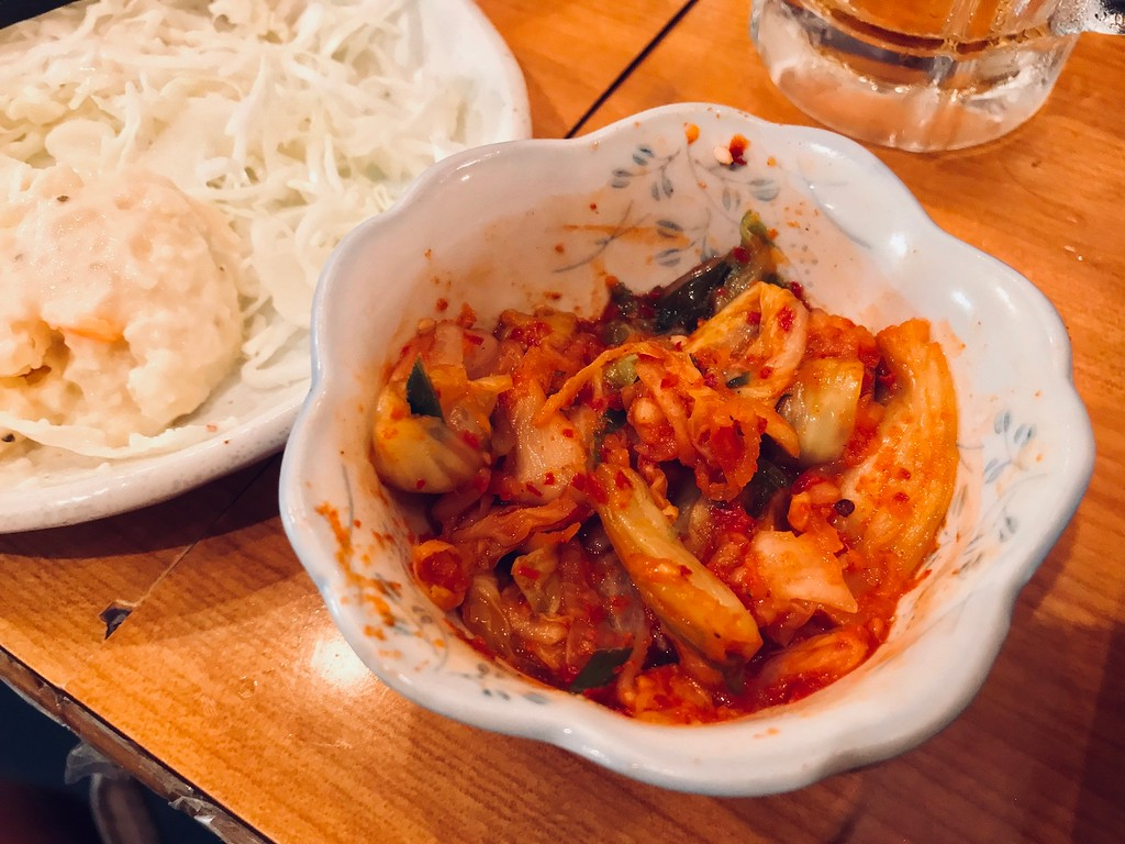 A small bowl of kimchi.