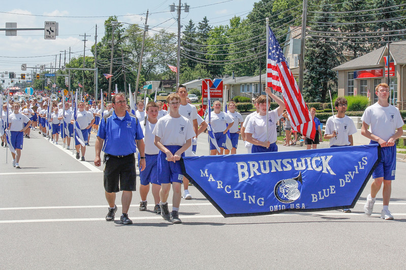 ALEC SMITH / GAZETTE Brunswick High School's marching band is shown on Center Road (state Route 303) on Sunday as part of the city's 2017 Summer Celebration parade. Shown at front from left are Jay Wardeska, high school band director; at left holding the banner is junior Cody Baker, with senior Sean Wiblin at right.
