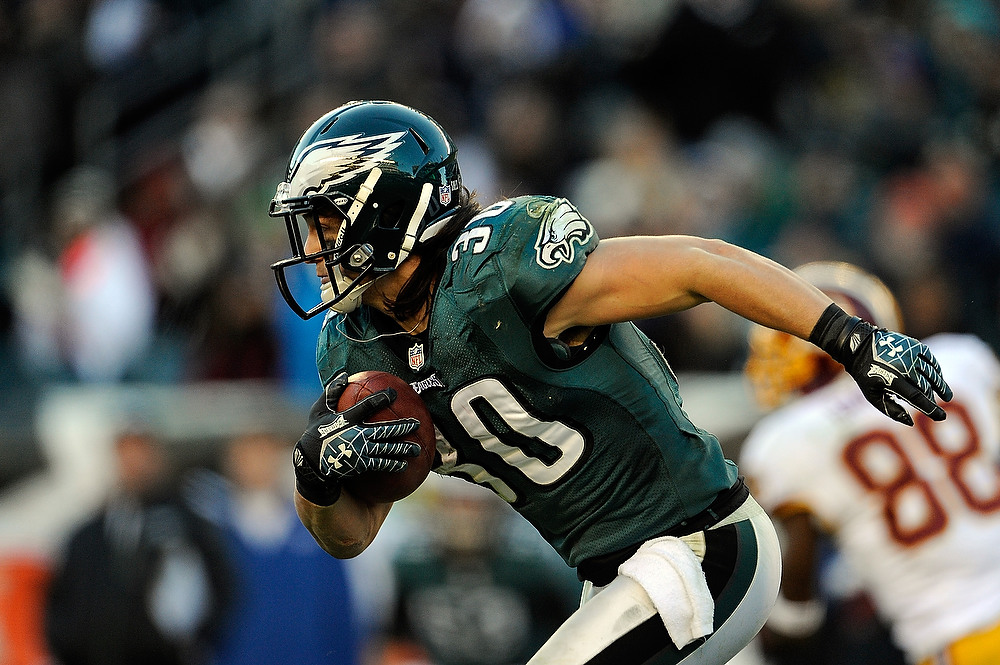 . Colt Anderson #30 of the Philadelphia Eagles runs up field after catching an interception thrown by Robert Griffin III #10 of the Washington Redskins during the second half at Lincoln Financial Field on December 23, 2012 in Philadelphia, Pennsylvania. (Photo by Patrick McDermott/Getty Images)