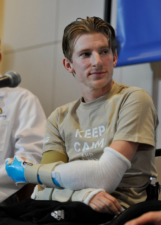 . Retired Infantryman Brendan M. Marrocco listens during a news conference Tuesday, Jan. 29. 2013 at Johns Hopkins hospital in Baltimore.  Marrocco received a transplant of two arms from a deceased donor after losing all four limbs in a 2009 roadside bomb attack in Iraq. (AP Photo/Gail Burton)
